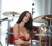 Jennifer in red lingerie by the drum set 9