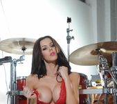 Jennifer in red lingerie by the drum set 11