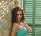 Jennifer teasing outdoors in her turqoise sports bra 5