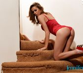Jennifer Ann teasing on the stairs in her red bodysuit 6
