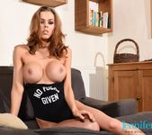 Jennifer Ann teasing in black bodysuit on the sofa 11