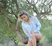 Rachel McDonald teasing by the tree 5