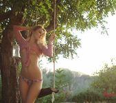 Rachel McDonald strips naked on the swing in the garden 5