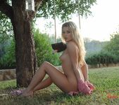 Rachel McDonald strips naked on the swing in the garden 16