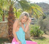 Rachel McDonald strips from her green top 2