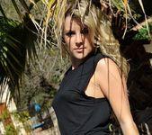 Rachel McDonald teasing in her black top and bottoms 4
