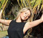 Rachel McDonald teasing in her black top and bottoms 6