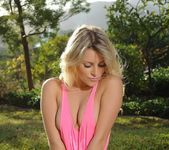 Rachel strips from her pink top and panties outdoors 5
