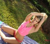 Rachel strips from her pink top and panties outdoors 6
