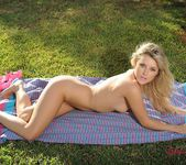 Rachel strips from her pink top and panties outdoors 13