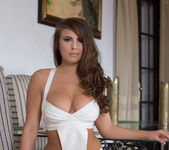Sarah McDonald strips out of her white bodysuit 2