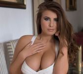 Sarah McDonald strips out of her white bodysuit 4