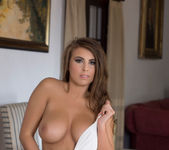 Sarah McDonald strips out of her white bodysuit 9