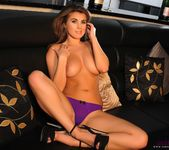 Sarah teasing in the lounge in her purple lingerie 15