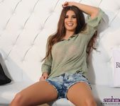 Sarah teases in her green top and denim shorts 6