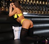 Sarah teases in her black and yellow lingerie on the couch 3