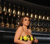 Sarah teases in her black and yellow lingerie on the couch 8