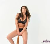 Sarah shows off her beautiful breasts in her black lingerie 4