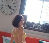 Summer teases on the red sofa in her yellow bras and panties 5