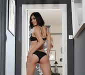 Summer teases in her black bras and panties with heels 3