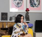 Summer teases on the yellow chair in her batman pajama top 4