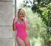 Melissa Debling teases in her pink bodysuit and blue heels 3