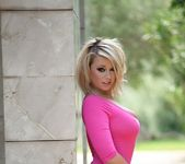 Melissa Debling teases in her pink bodysuit and blue heels 4