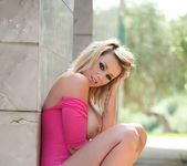 Melissa Debling teases in her pink bodysuit and blue heels 10