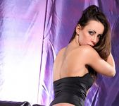Lara Sancto teases on the sofa in her black bodysuit 4