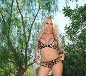 Cara Brett strips from her leopard print bikini 3