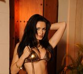 Gemma strips from her gold bikini 8