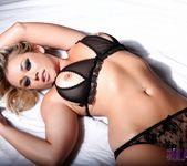 Melissa Debling teasing on the bed 8