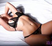 Melissa Debling teasing on the bed 11
