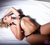 Melissa Debling teasing on the bed 12