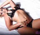 Melissa Debling teasing on the bed 15