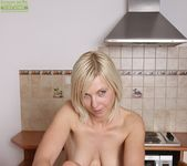 Emilia - saggy tits mature in the kitchen 8