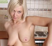 Emilia - saggy tits mature in the kitchen 18