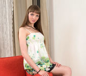 Viera undressing on the couch - Nubiles 4