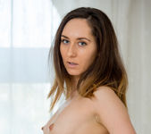 Sabrine getting naked on the bed 7