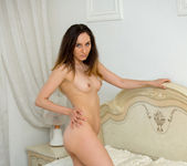 Sabrine getting naked on the bed 8