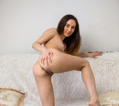 Sabrine spreading her pussy on the bed 20