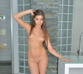 Diana Dolce spreading on the kitchen stool 9