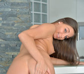 Diana Dolce spreading on the kitchen stool 12