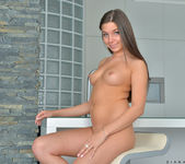 Diana Dolce spreading on the kitchen stool 13