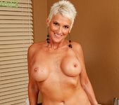 Lexy Cougar - short haired mature with fake tits 10