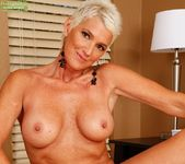 Lexy Cougar - short haired mature with fake tits 17