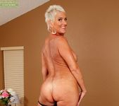 Lexy Cougar - short haired mature getting naked 10