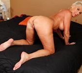 Lexy Cougar - short haired mature getting naked 14