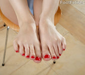 Ember Stone Gives a Footjob with Her Bright Red Toes 4