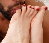 Tina Kay getting her feet loved 10